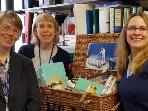 Colleagues with hamper provided as a prize in the SOM's photo competition